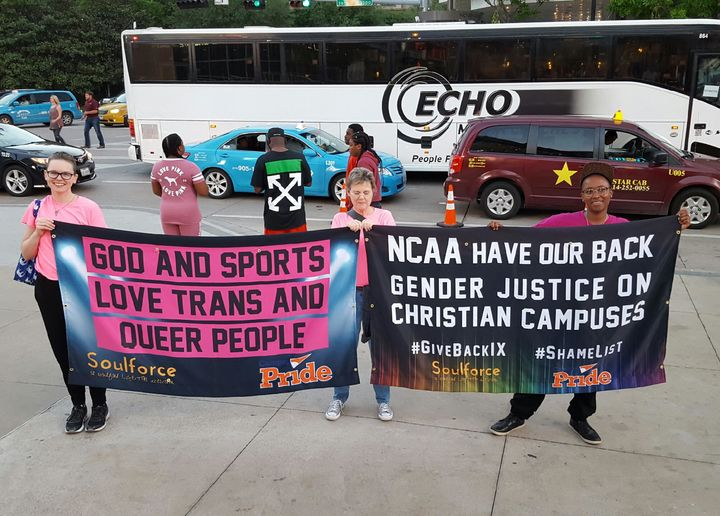 <p>Soulforce activists Haven Herrin, Beth Mims, and D.J. Hudson receive hi-fives from fans as they show off the banners that got the group threatened with criminal trespass and ejected from the American Airlines Center at the Final Four in Dallas. </p>