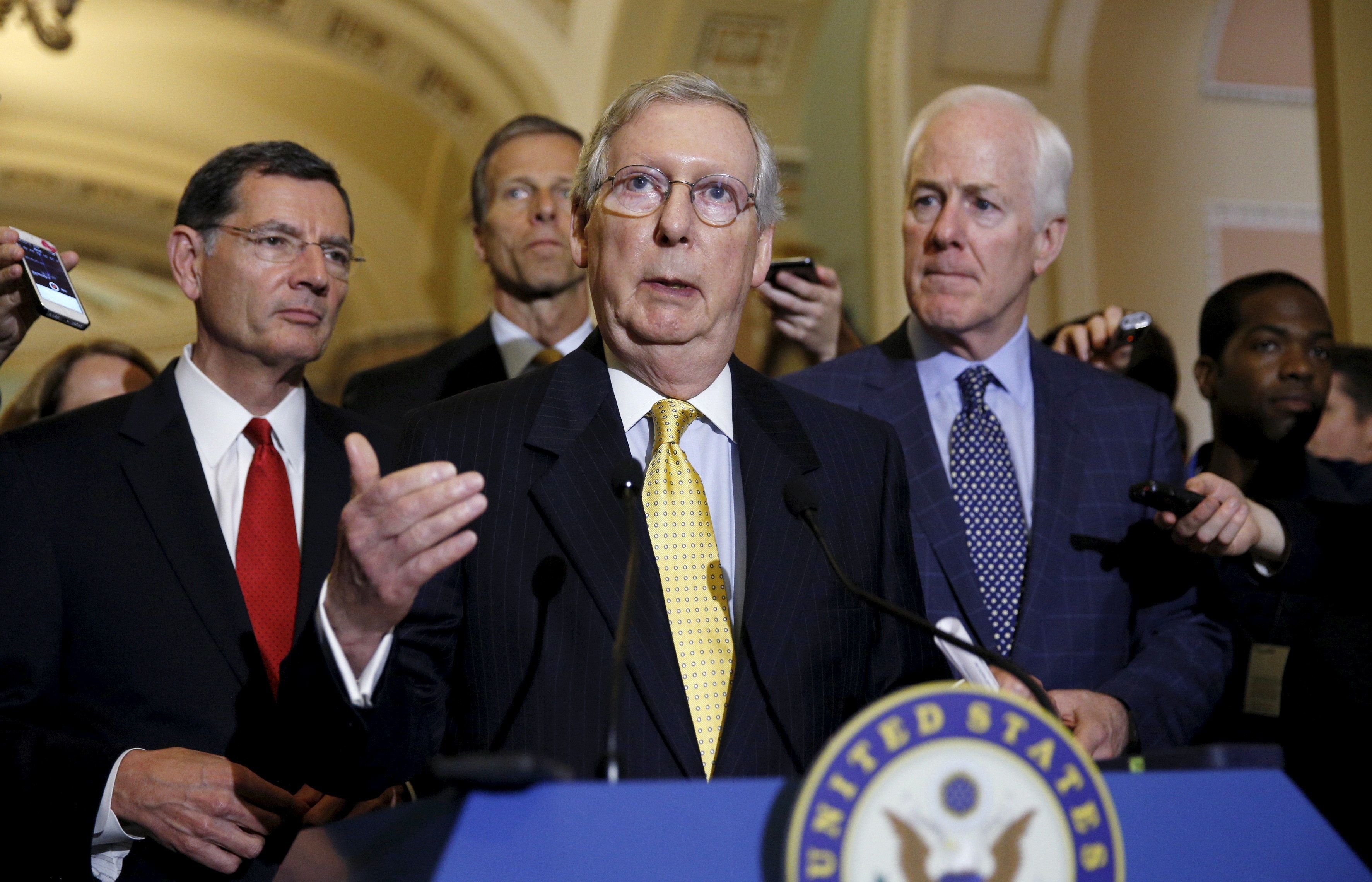 Senate Majority Leader Mitch McConnell speaks to reporters following the weekly policy lunch at the U.S. Capitol in Washington May 5, 2015. Flanking McConnnell are Senators' John Barrasso  (R-WY) (L) and John Cornyn (R-TX). REUTERS/Kevin Lamarque