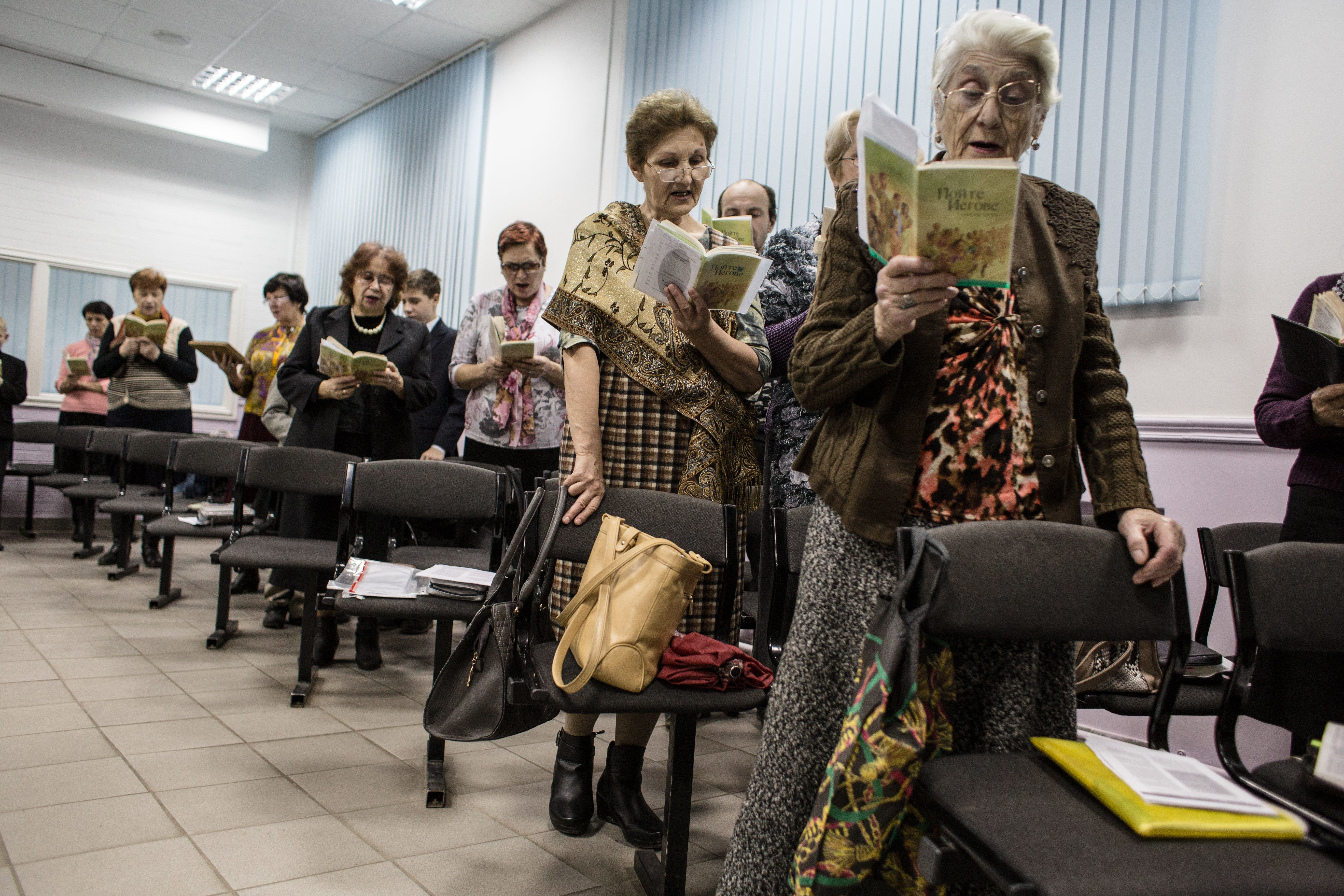 ROSTOV-ON-DON, RUSSIA - 13 November, 2015: Jehovah's witnesses sing songs during the meeting in Rostov-on-Don. Although Rostov-on-Don is only 80 km away from Taganrog, the organization is not banned there, and people are free to gather and hold meetings. 16 Jehovah's Witnesses are accused of extremist activity in Taganrog, Russia, 80 km away from Rostov-on-Don. (Photo by Alexander Aksakov/For The Washington Post via Getty Images).