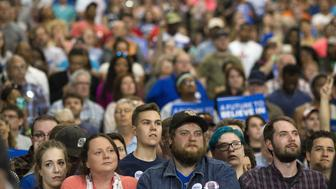 Attendees listen during a campaign event for Senator Bernie Sanders, an independent from Vermont and 2016 Democratic presidential candidate, not pictured, in Huntington, West Virginia, U.S., on Tuesday, April 26, 2016. Sanders' single win in Rhode Island out of the five contests held on Tuesday puts his opponent Hillary Clinton on the brink of the Democratic presidential nomination. Photographer: Ty Wright/Bloomberg via Getty Images