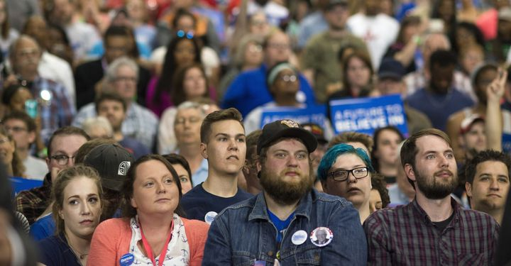 Attendees listen during an election night campaign event for Senator Bernie Sanders in Huntington, West Virginia on Tuesday,