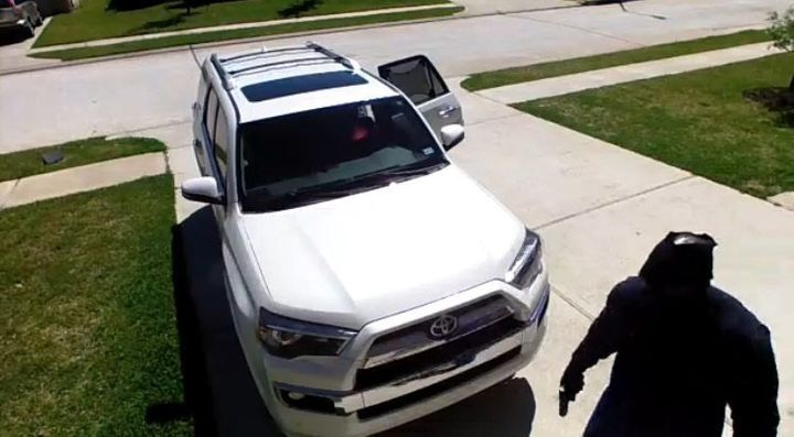A screenshot of the video that captured the alleged abduction. The suspect appears to be holding a gun.