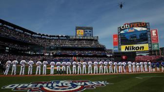 Apr 3, 2017; New York City, NY, USA; The New York Mets stand as a helicopter makes a flyover following the national anthem before a game against the Atlanta Braves at Citi Field. Mandatory Credit: Brad Penner-USA TODAY Sports