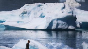 NARSAQ, GREENLAND - JULY 30: Icebergs are seen floating in the water on July 30, 2013 in Narsaq, Greenland. As cities like Miami, New York and other vulnerable spots around the world strategize about how to respond to climate change, many Greenlanders simply do what theyve always done: adapt.  'Were used to change, said Greenlander Pilu Neilsen. 'We learn to adapt to whatever comes. If all the glaciers melt, well just get more land.  (Photo by Joe Raedle/Getty Images)