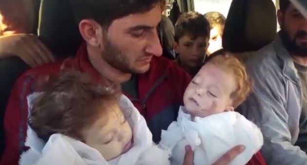 In a video, father Abdel Hameed Alyousef carries his twin daughters who were killed in the gas attack...