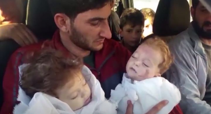 In a video, father Abdel Hameed Alyousef carries his twin daughters who were killed in the gas attack in the province of Idlib earlier this week.