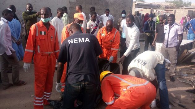 Officials recover bodies in Maiduguri, Nigeria after four female teenage suicide bombers killed two people...
