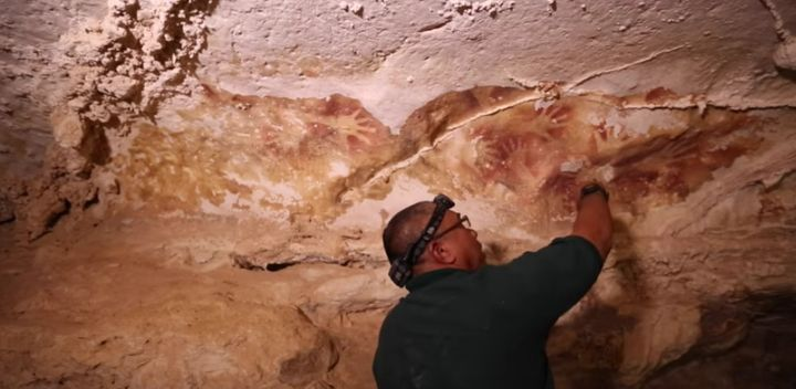 Images of cave paintings in Indonesia, dating back over 30,000 years.