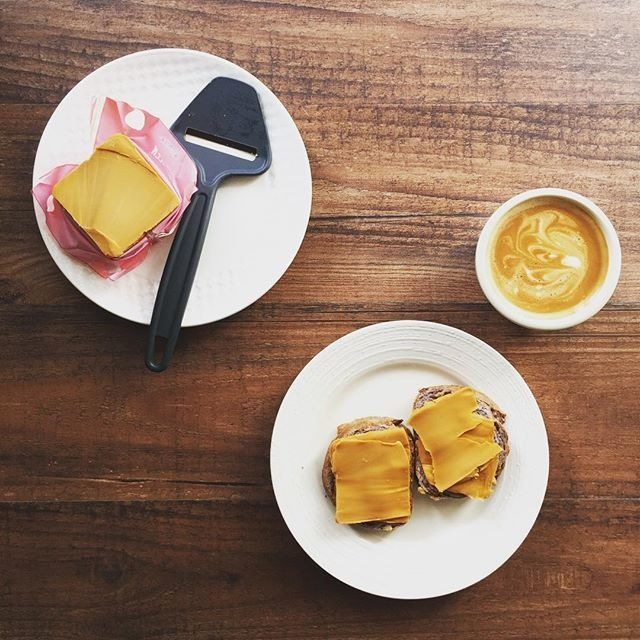 Coffee and brunost cheese slices on bread.