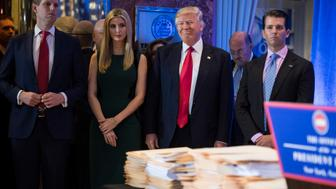 NEW YORK, NY - JANUARY 11: President-elect Donald Trump, Eric Trump, left, Ivanka Trump, and Donald Trump Jr., listen during a press conference at Trump Tower in New York, NY on Wednesday, Jan. 11, 2017. (Photo by Jabin Botsford/The Washington Post via Getty Images)