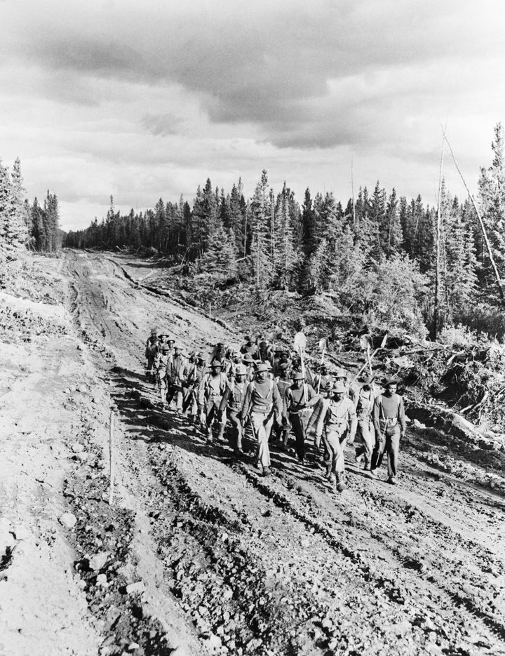 A photo from 1942 shows black soldiers working on the Alaska Highway.