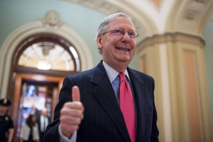 Mitch McConnell gives a thumbs up afterchanging the Senate rules to force through Supreme Court nominee Neil Gorsuch's