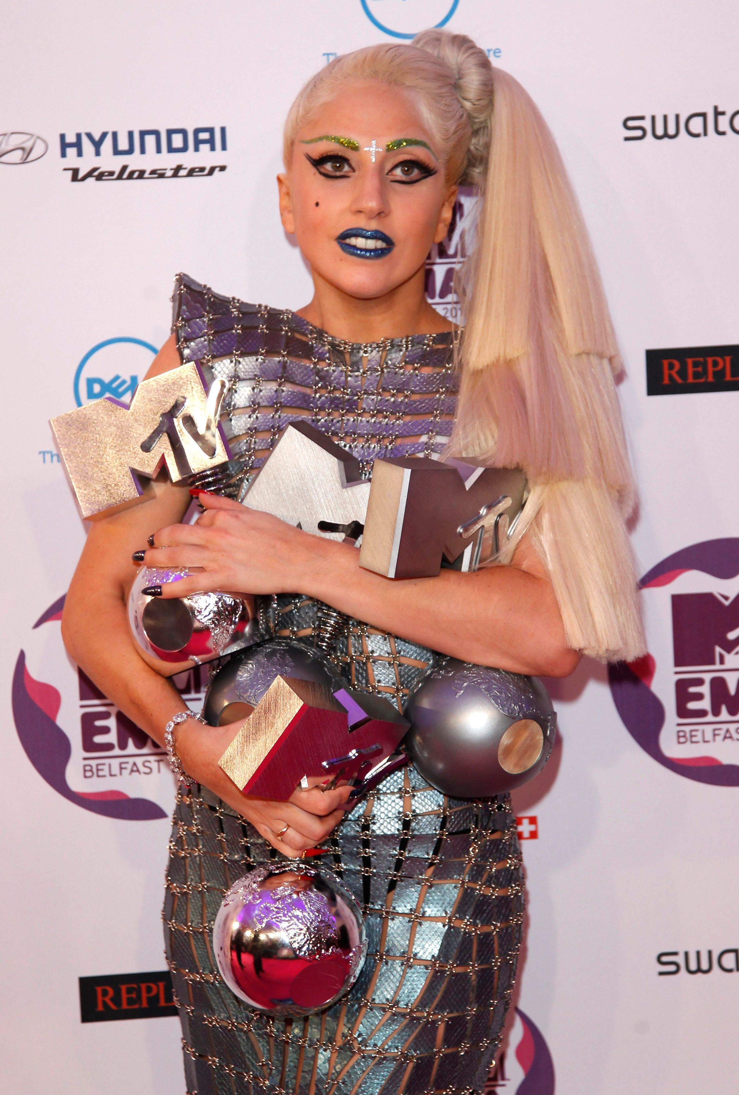 Lady Gaga holds her four awards after the show at the MTV Europe Music Awards show in Belfast November 6, 2011.                          REUTERS/Luke Macgregor (NORTHERN IRELAND  - Tags: ENTERTAINMENT PROFILE SOCIETY)
