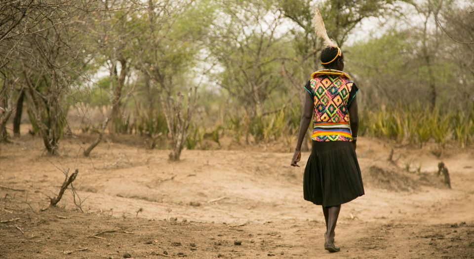 Cheposait Adomo walks in the bush in Kenya's West Pokot near where she was bitten repeatedly by a