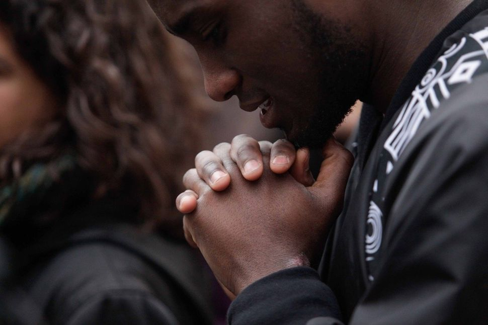 A protestor prays during a rally for black lives in New York City.