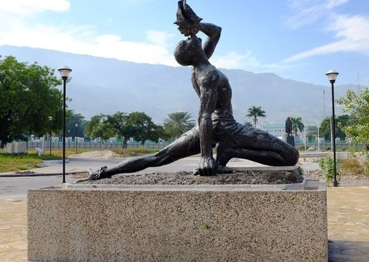 """<em>""""Neg Mawon"""" or """"Unknown Slave"""" statue; on the boulevard Champ de Mars. A powerful symbol of slavery and freedom, the conc"""