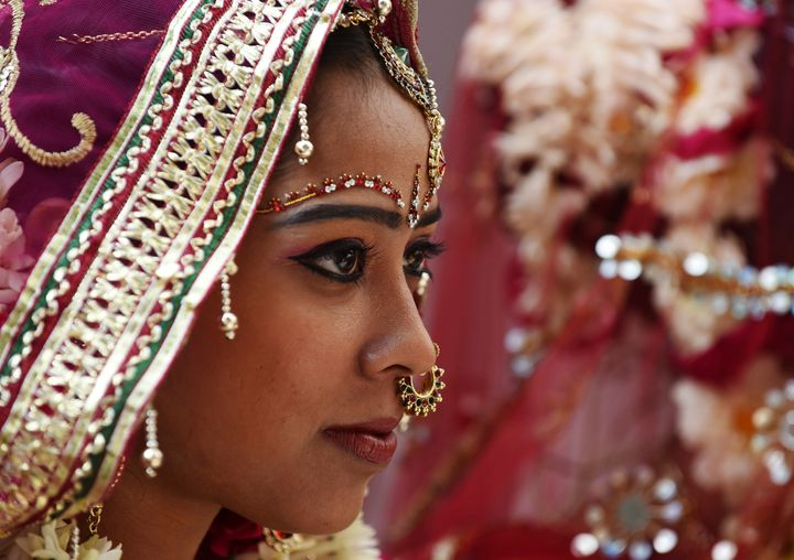 Brides in India often wear a maang tikka upon their foreheads. It symbolizes the bride's third eye.