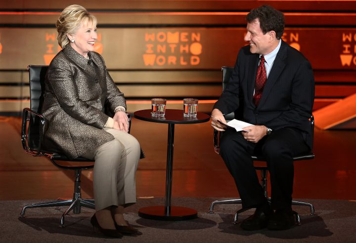 Former United States Secretary of State Hillary Clinton (L) speaks with journalist Nicholas Kristof on stage at the 8th Annua