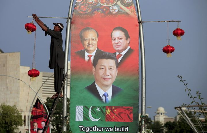 A 2015 poster in Islamabad shows Pakistan's President Mamnoon Hussain (L), China's President Xi Jinping © and Pakistan's Prim