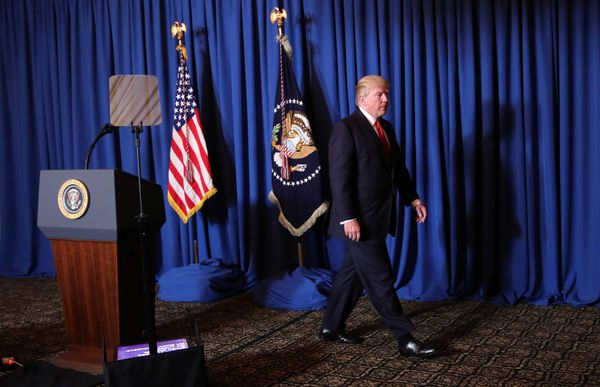 President Donald Trump leaves after delivering a statement at his Mar-a-Lago estate in Palm Beach, Florida.