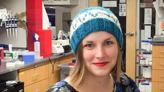 Heidi Arjes poses in a resistor hat in her lab at Stanford University