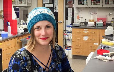 Microbiologist Heidi Arjes shows off a resistor hat in her Stanford University lab.