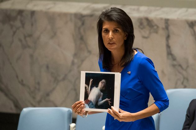 US ambassador to UN Nikki Hayley holding photo of a victim of the chemical
