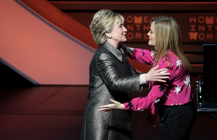 Former U.S. Secretary of State Hillary Clinton hugs Samantha Bee before an interview with Nicholas Kristof during the Women i