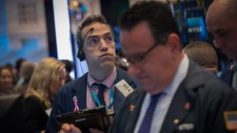 A trader works on the floor at the closing bell of the Dow Jones at the New York Stock Exchange, April 6, 2017 in New York.  Wall Street stocks finished modestly higher on Thursday, shrugging off concerns about US monetary policy ahead of the closely watched March jobs report. US equities steadied after Federal Reserve meeting minutes had prompted a sell-off Wednesday afternoon due to concerns about tightening monetary policy.  / AFP PHOTO / Bryan R. Smith        (Photo credit should read BRYAN R. SMITH/AFP/Getty Images)