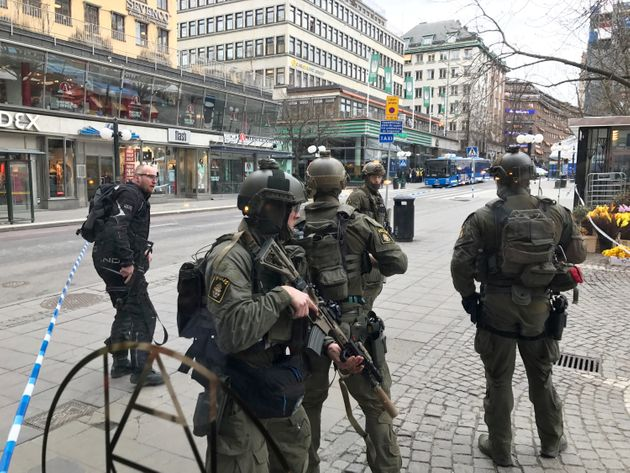 Sweden's police officers stand guard in central