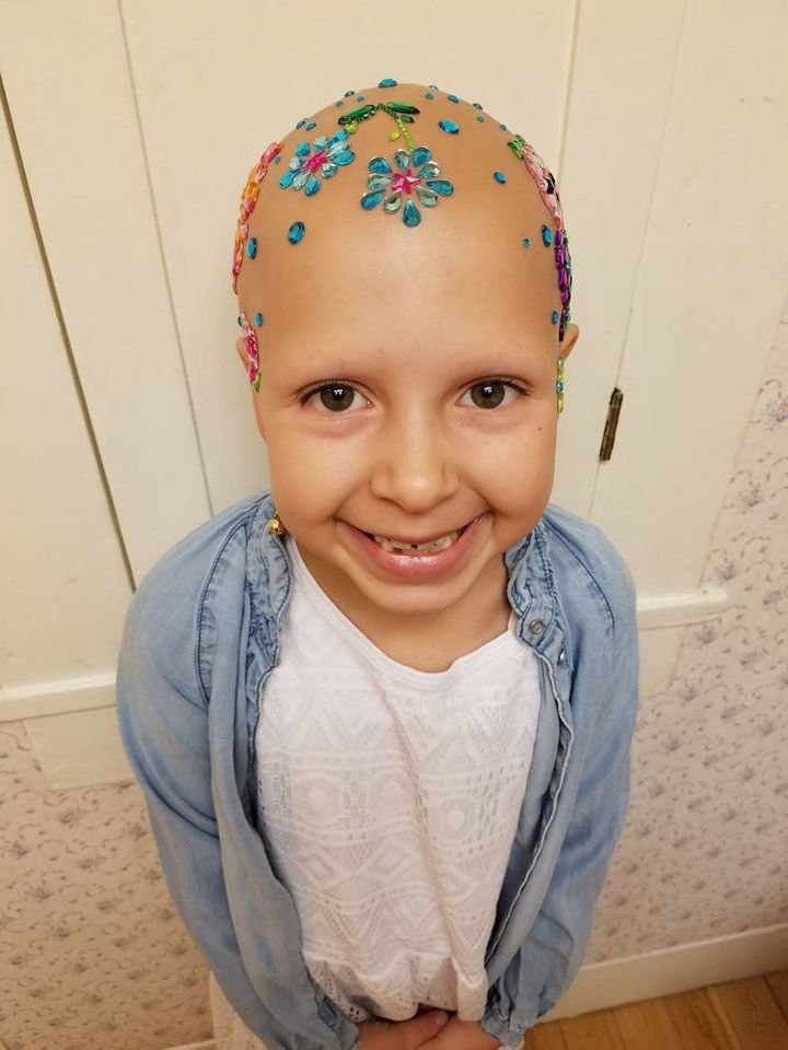 "As ""Crazy Hair Day"" at Gianessa's school approached, Wride looked for a creative idea for her daughter. She found it in the form of jeweled scrapbooking stickers at Walmart."