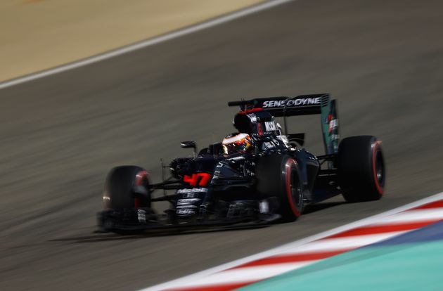 A McLaren-Honda Formula 1 car racing in Bahrain in