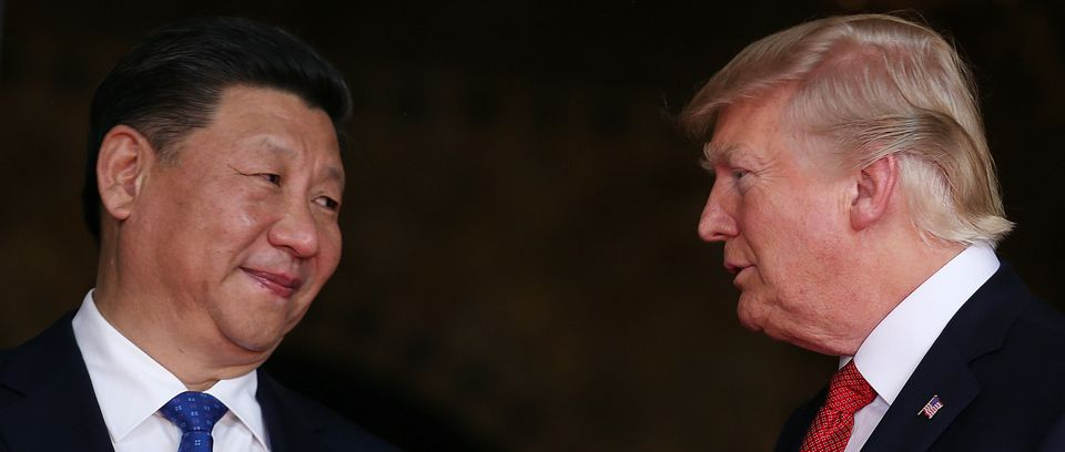 U.S. President Donald Trump welcomes Chinese President Xi Jinping at Mar-a-Lago in Palm Beach, Florida,...