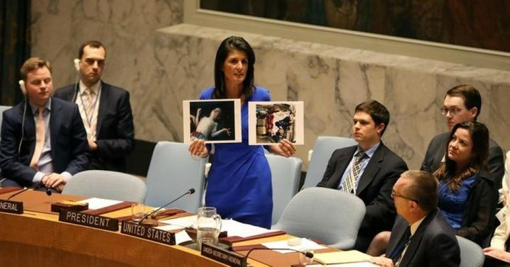 <p><strong><em>U.S. Ambassador to the United Nations Nikki Haley holds photos of victims as she speaks as the U.N. Security Council meets in an emergency session on April 5, 2017, about Syria.</em></strong>  </p>