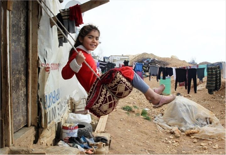 <p><strong><em>A girl plays on a swing, in the Faida informal tented settlement for Syrian refugees, in the Bekaa Valley.</em></strong></p>