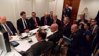 U.S. President Donald Trump is shown in an official White House handout image meeting with his National  Security team and being briefed by Chairman of the Joint Chiefs of Staff General Joseph Dunford via secure video teleconference after a missile strike on Syria while inside the Sensitive Compartmented Information Facility at his Mar-a-Lago resort in West Palm Beach, Florida, U.S. April 6, 2017. White House Press Secretary Sean Spicer stated that this image has been digitally edited for security purposes when he released the photo via Twitter on April 7, 2017. Pictures clockwise from top L: Deputy Chief of Staff Joe Hagin, Senior Advisor Jared Kushner, Treasury Secretary Steven Mnuchin, Commerce Secretary Wilbur Ross, White House Press Secretary Sean Spicer, President Trump, Secretary of State Rex Tillerson, Senior advisor Steve Bannon, Senior advisor Stephen Miller,  national security aide Michael Anton, Deputy National Security Advisor for Strategy Dina Powell, National Economic Council Director Gary Cohn, National security adviser Lt. Gen. H.R. McMaster and Chief of Stafff Reince Priebus.    The White House/Handout via REUTERS ATTENTION EDITORS - THIS IMAGE WAS PROVIDED BY A THIRD PARTY. EDITORIAL USE ONLY.  IT IS DISTRIBUTED, EXACTLY AS RECEIVED BY REUTERS, AS A SERVICE TO CLIENTS. NOT FOR SALE FOR MARKETING OR ADVERTISING CAMPAIGNS     TPX IMAGES OF THE DAY