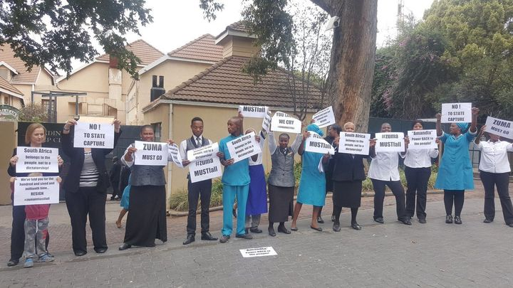 Employees in the hospitality sector in Sandton use their lunch break to protest against Zuma.