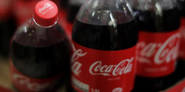 Coke hopes no one notices all the plastic bottles floating for Fish scale coke