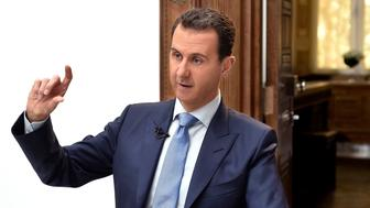 Syria's President Bashar al-Assad speaks during an interview with Croatian newspaper Vecernji List in Damascus, Syria, in this handout picture provided by SANA on April 6, 2017. SANA/Handout via REUTERS ATTENTION EDITORS - THIS IMAGE WAS PROVIDED BY A THIRD PARTY. EDITORIAL USE ONLY. REUTERS IS UNABLE TO INDEPENDENTLY VERIFY THIS IMAGE.