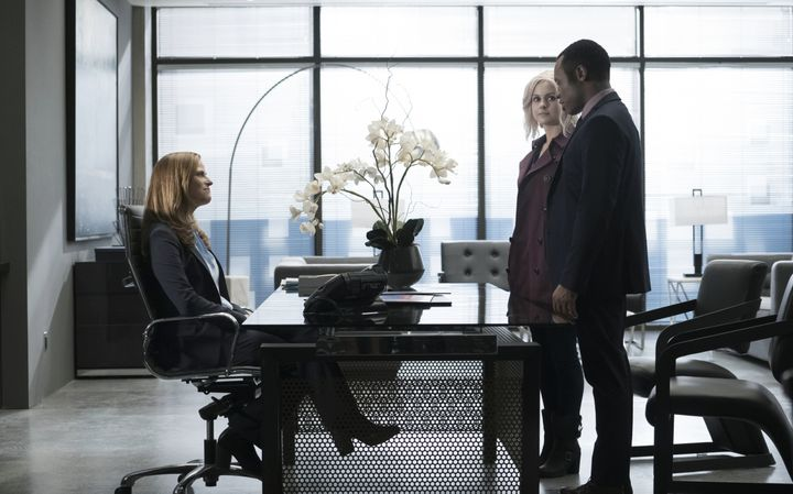 Liv (Rose McIver) and Clive (Malcolm Goodwin) meet with the CEO of the pro-zombie organization.