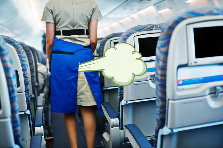 Airplane staff walking in the seat isle.