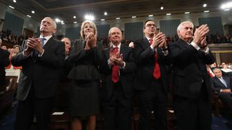 WASHINGTON, USA - FEBRUARY 28: (----EDITORIAL USE ONLY  MANDATORY CREDIT - 'JIM LO SCALZO / EPA / POOL' - NO MARKETING NO ADVERTISING CAMPAIGNS - DISTRIBUTED AS A SERVICE TO CLIENTS----) (L-R) Cabinet members James Mattis, Betsy DeVos, Jeff Sessions, Steve Mnuchin and Rex Tillerson applaud as US President Donald J. Trump delivers his first address to a joint session of Congress from the floor of the House of Representatives in Washington, United States on February 28, 2017. Traditionally the first address to a joint session of Congress by a newly-elected president is not referred to as a State of the Union.  (Photo by Jim Lo Scalzo/EPA/Pool/Anadolu Agency/Getty Images)