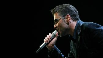 "British singer George Michael performs during the first concert of his world tour ""25 Live"" at Sant Jordi Stadium in Barcelona September 23, 2006.REUTERS/Albert Gea (SPAIN)"