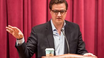 PHILADELPHIA, PA - MARCH 23:  Chris Hayes, Political commentator, journalist, author and hosts of 'All In with Chris Hayes' on MSNBC attends Chris Hayes signs copies of his new book 'A Colony In A Nation' at Free Library of Philadelphia on March 23, 2017 in Philadelphia, Pennsylvania.  (Photo by Gilbert Carrasquillo/Getty Images)