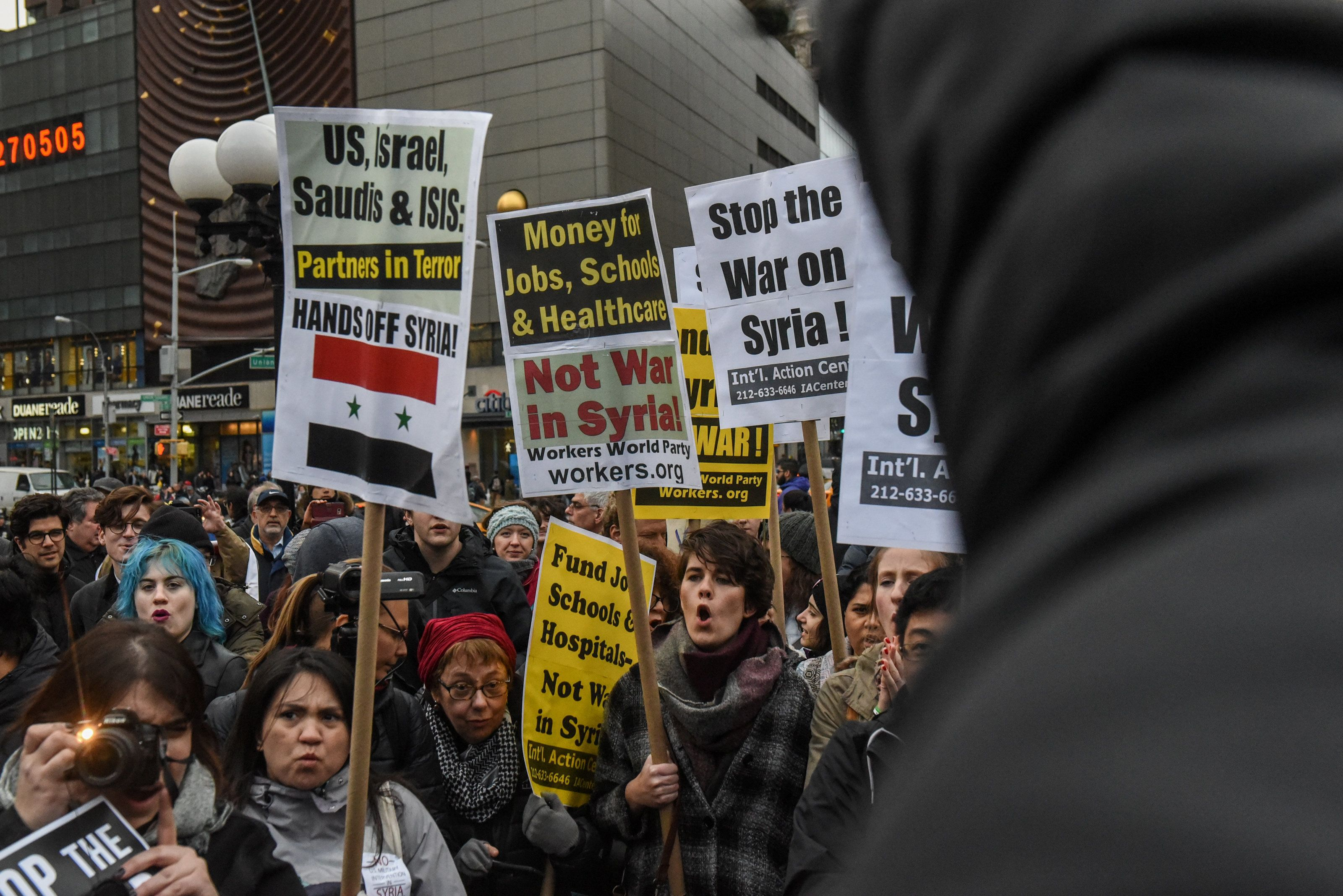 People participate in a demonstration against the recent U.S. strike in Syria, in New York, U.S., April 7, 2017. REUTERS/Stephanie Keith