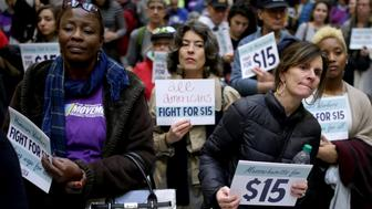 BOSTON, MA - NOVEMBER 29: Hilda Haye, left and Lisa Murphy, right, who are from Cape Cod, take part in a National Day of Action 15 dollar per hour minimum wage protest at the Massachusetts State House in Boston on Nov. 29, 2016. (Photo by Jonathan Wiggs/The Boston Globe via Getty Images)