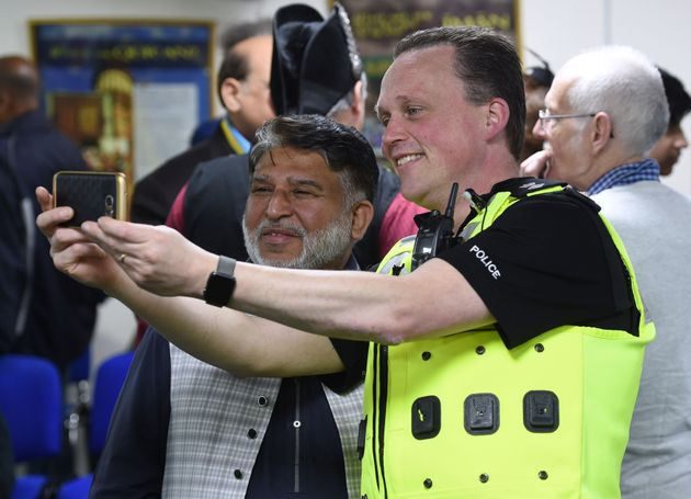 West Midlands Chief Superintendent Chris Johnson takes a selfie with Makhdoom Ahmad Chisti