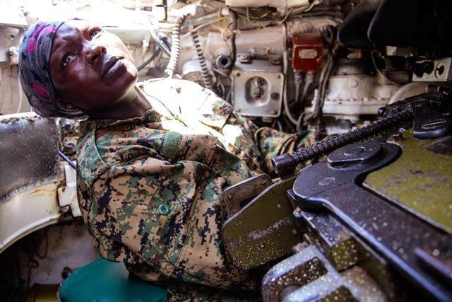 Based at the Arabiska Forward Operating Base in south-central Somalia Corporal Stella Rose Ahinga seen here taking instruction from her tank commander during afternoon drills is one of a growing number of African women joining the ranks of military and police