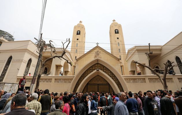 Egyptians gather in front of a Coptic church that was bombed on Sunday in Tanta, Egypt, April 9, 2017....