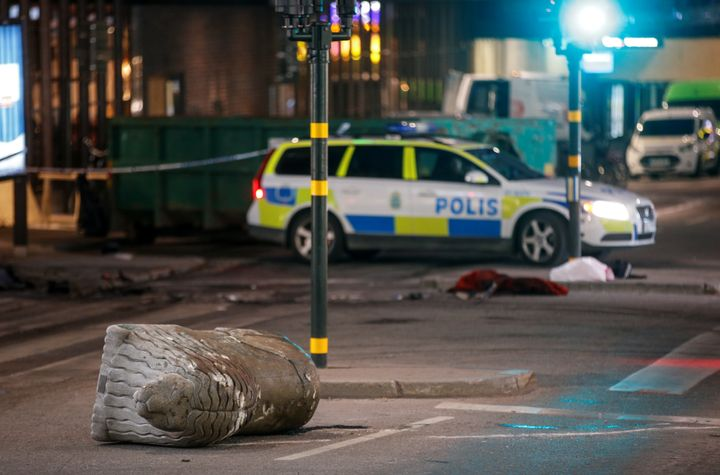 A turned over, 'Stockholmslejon', a concrete traffic stopper, is seen outside the roped off area near the department store Ah
